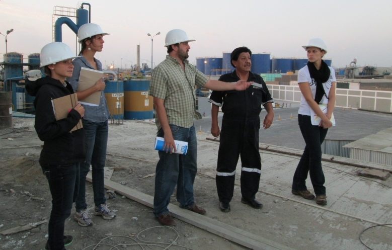Students taking a tour of a processing plant.
