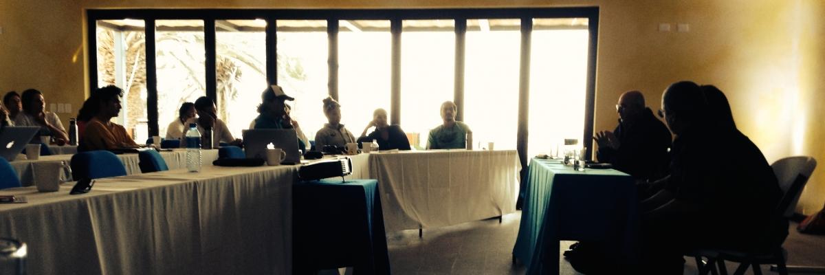 Workshop participants watching a presentation