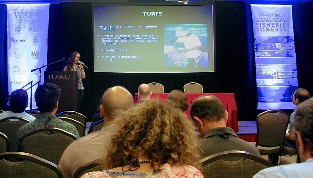 Presenter in front of screen at conference
